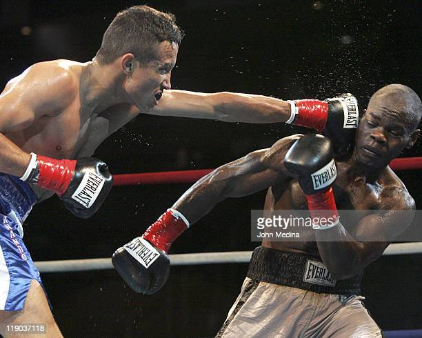 Super Bantamweight's Fernando Beltran Jr and Felix Flores in action during 'Fight Night at the Tank' July 21 2005 at HP Pavilion in San Jose...