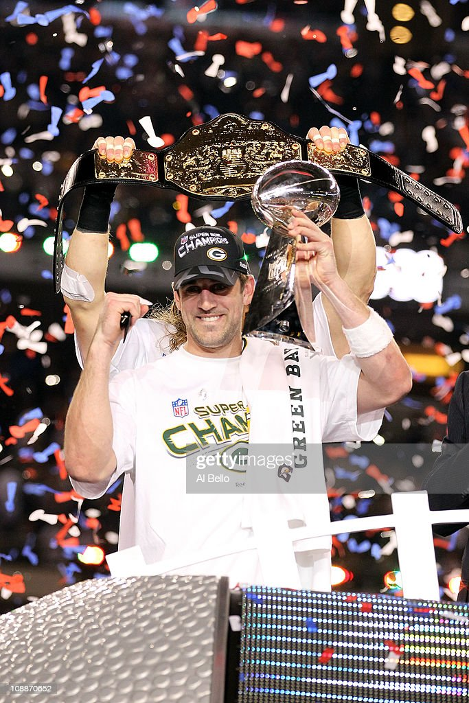 Super Bowl MVP <a gi-track='captionPersonalityLinkClicked' href=/galleries/search?phrase=Aaron+Rodgers+-+American+Football+Quarterback&family=editorial&specificpeople=215257 ng-click='$event.stopPropagation()'>Aaron Rodgers</a> #12 of the Green Bay Packers holds up the Vince Lombardi Trophy as Clay Matthews #52 holds up a championship belt after winning Super Bowl XLV 31-25 against the Pittsburgh Steelers at Cowboys Stadium on February 6, 2011 in Arlington, Texas.