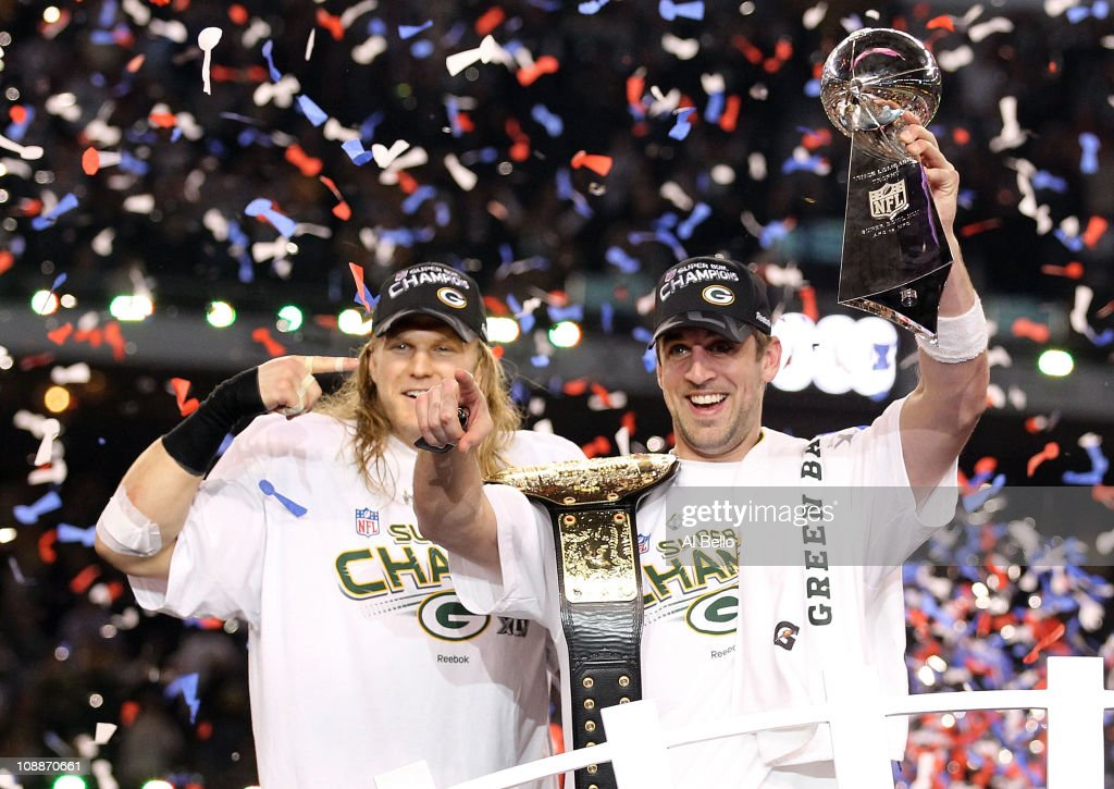 Super Bowl MVP <a gi-track='captionPersonalityLinkClicked' href=/galleries/search?phrase=Aaron+Rodgers+-+American+Football+Quarterback&family=editorial&specificpeople=215257 ng-click='$event.stopPropagation()'>Aaron Rodgers</a> #12 of the Green Bay Packers holds up the Vince Lombardi Trophy as Clay Matthews #52 looks on after winning Super Bowl XLV 31-25 against the Pittsburgh Steelers at Cowboys Stadium on February 6, 2011 in Arlington, Texas.