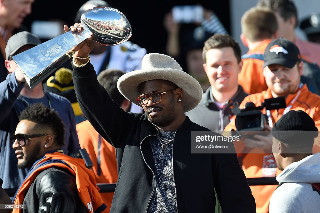 Super Bowl MVP Von Miller hoists the Lombardi Trophy on the steps of the City and County Building during the Denver Broncos Super Bowl championship celebration and parade on Tuesday February 9, 2016.