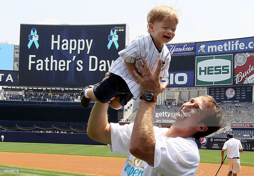 Super Bowl XLIV MVP Drew Brees of the New Orleans Saints plays with his son Baylen prior to the the New York Yankees game against the New York Mets on June 20, 2010 at Yankee Stadium in the Bronx borough of New York City.