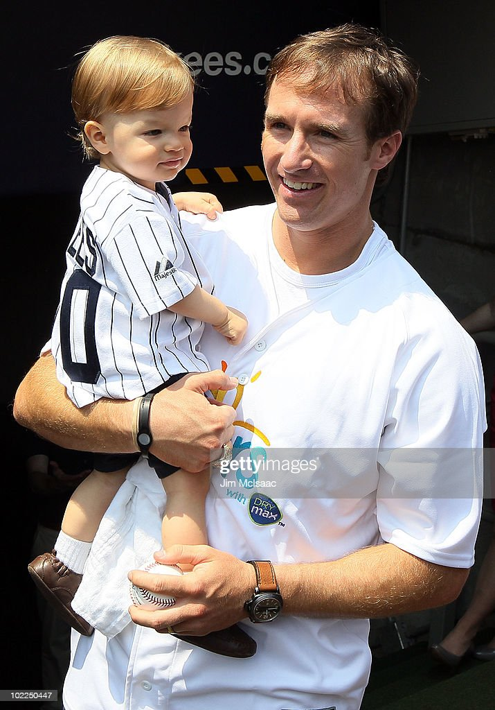 Super Bowl XLIV MVP Drew Brees of the New Orleans Saints stands with his son Baylen prior to the the New York Yankees game against the New York Mets on June 20, 2010 at Yankee Stadium in the Bronx borough of New York City.