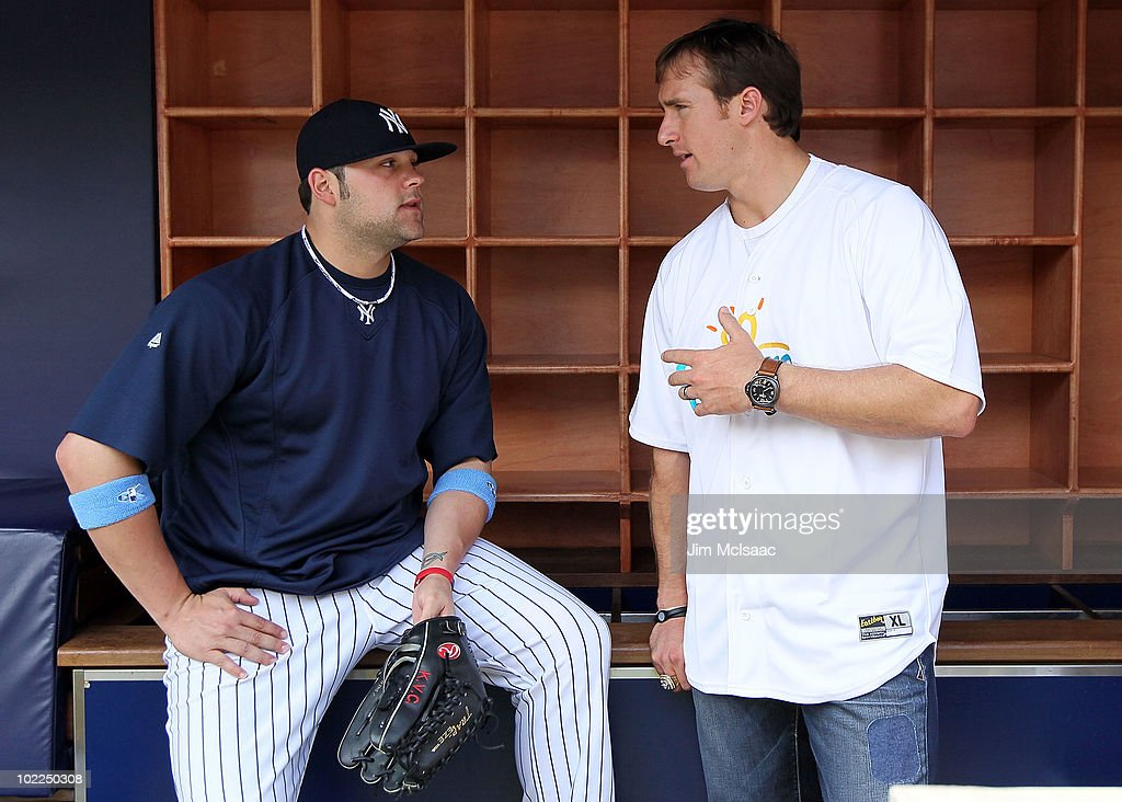Super Bowl XLIV MVP Drew Brees of the New Orleans Saints talks with Joba Chamberlain #62 of the New York Yankees prior to the game against the New York Mets on June 20, 2010 at Yankee Stadium in the Bronx borough of New York City.