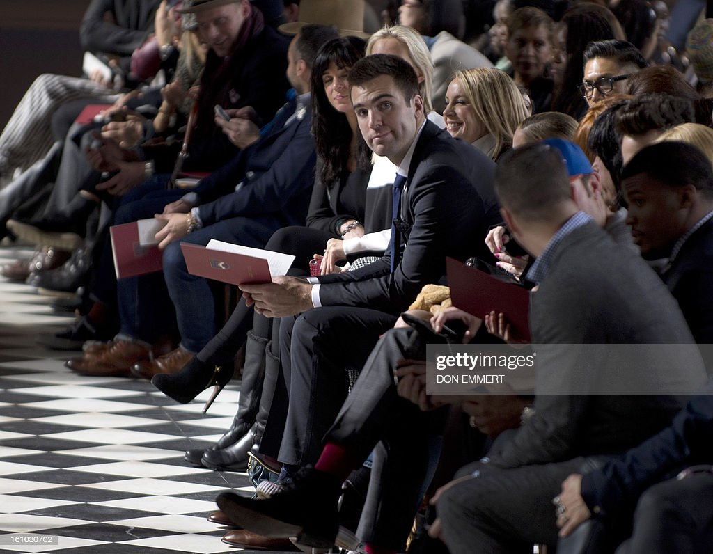 Super Bowl XLVII most valuable player Joe Flacco (C) attends the Tommy Hilfiger show at the Mercedes-Benz fashion week February 8, 2013 in New York. AFP PHOTO/DON EMMERT