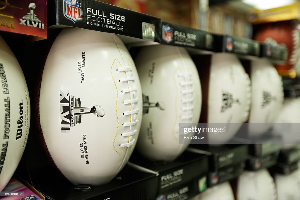 Super Bowl XLVII themed footballs are offered for sale on February 1, 2013 in New Orleans, Louisiana.