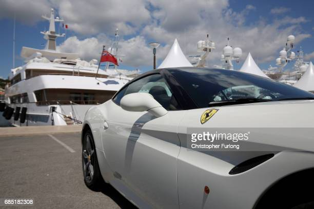A super car and luxury yachts berth next to the Palais de Festivals as owners and movie company's chartering the yachts attend the Cannes Film...