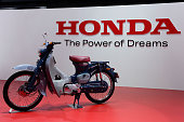 Super Cub concept motor cycle is displayed at the Honda booth during the media preview ahed of The 44th Tokyo Motor Show 2015 at Tokyo Big Sight on...