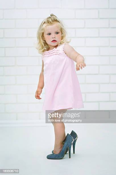 Super cute little girl in mom's high hills