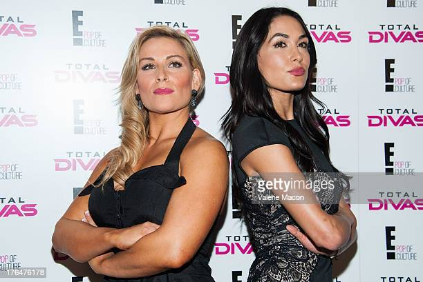 Super Divas Natalya and Brie Bella attend WWE SummerSlam Press Conference at Beverly Hills Hotel on August 13 2013 in Beverly Hills California