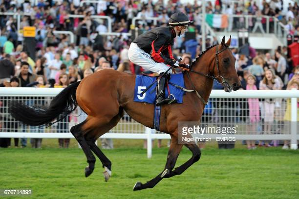 Super Duplex ridden by jockey Simon Pearce going to post prior to the Weatherbys Bloodstock Insurance Handicap