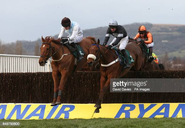 Super Duty ridden by Derek O'Connor and Becauseicouldntsee ridden by B O'Neill jump the fence during the Fulke Walwyn Kim Muir Challenge Cup Handicap...