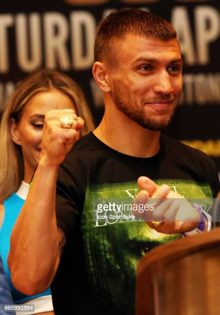 Super Featherweight boxer Vasyl Lomachenko shows off his new ring during a Top Rank Championship Boxing Press Conference on April 06 at MGM National...