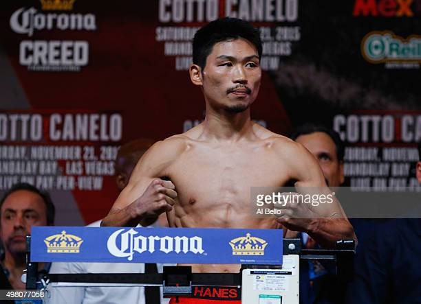 WBC super featherweight champion Takashi Miura poses on the scale during his official weighin at the Mandalay Bay Events Center on November 20 2015...