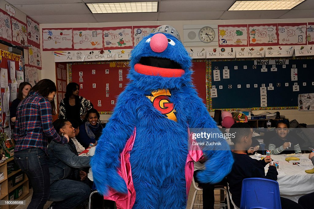Super Grover teaches kids to be a super hero at the WHEDCo classroom on January 24, 2013 in New York City.