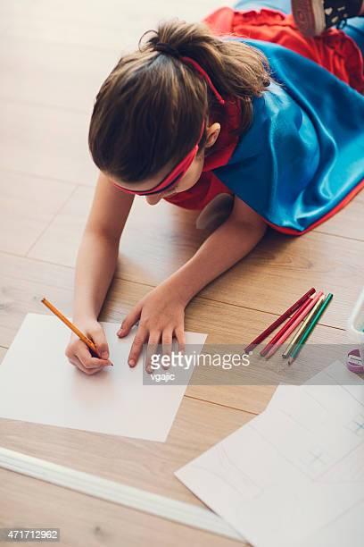 スーパーヒーローの小さな女の子のカラーリングと図面。