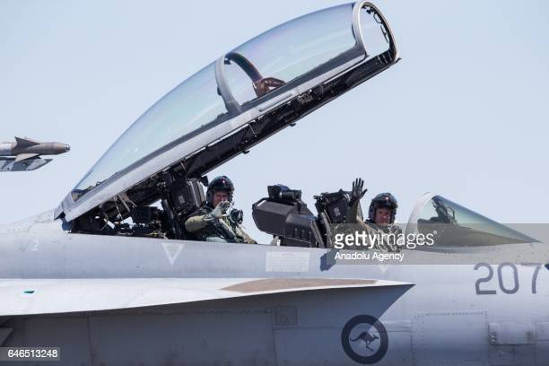 Super Hornet by Boeing operated by the ADF landed taxi's on the runway with its hatch and wings lifted up as the pilots wave to the crowd during the...