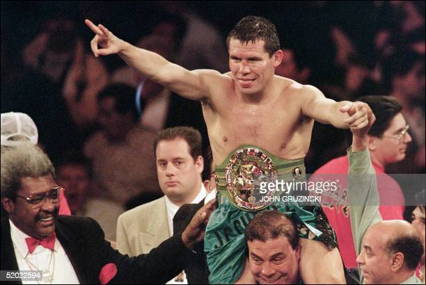 WBC super lightweight champion Julio Cesar Chavez of Mexico celebrates after he retained his title with a unanimous 12round decision over Giovanni...