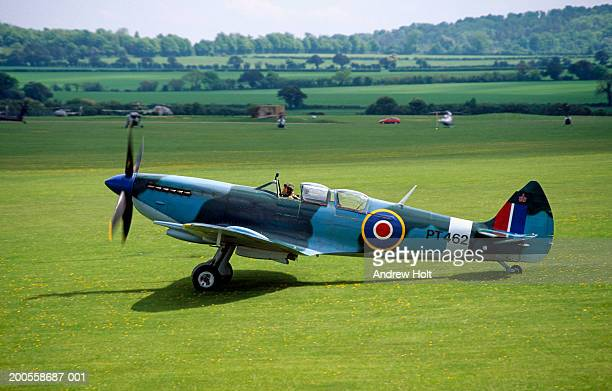 Super marine Spitfire aircraft on grass airfield