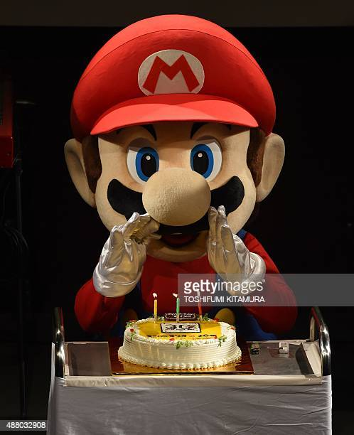 'Super Mario' attempts to blow out the candles on a cake during celebrations and a live performance of the most wellknown Mario music to mark the...