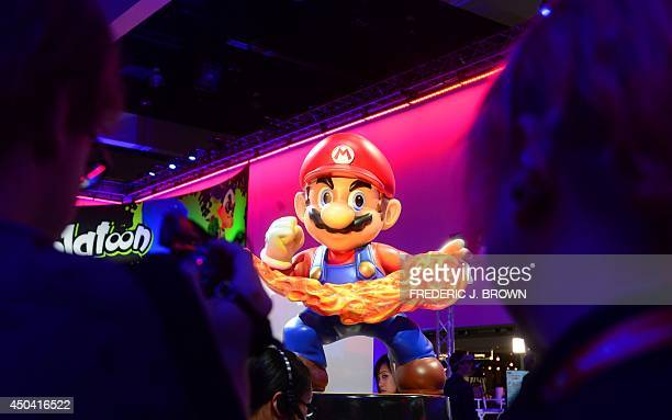 A Super Mario display at the Nintendo section attracts attention at the annual E3 video game extravaganza in Los Angeles California on June 10 2014...