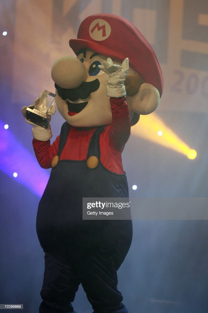 Super Mario picks up the award after 'New Super Mario Bros' won 'Top Game' at the Jetix Kids Award 2006 on October 29, 2006 in Berlin, Germany.