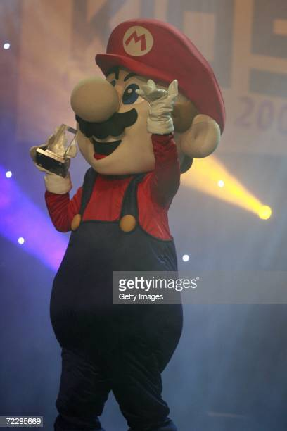 Super Mario picks up the award after 'New Super Mario Bros' won 'Top Game' at the Jetix Kids Award 2006 on October 29 2006 in Berlin Germany