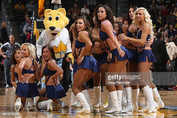 Super mascot Rocky performs with the Denver Nuggets Dancers during a break in the action between the Houston Rockets and the Denver Nuggets at Pepsi...