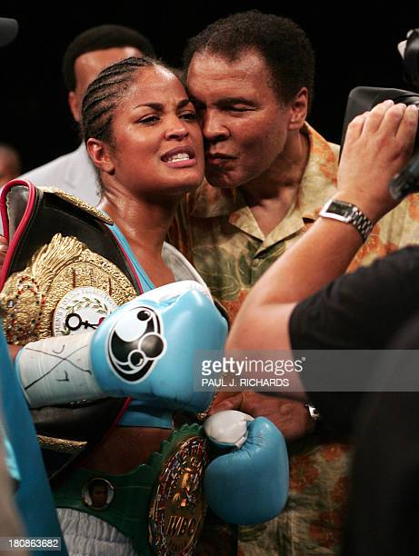 Super Middleweight Champion Laila Ali is kissed by her father boxing legend Muhammad Ali following her third round TKO victory over Erin Toughill 11...
