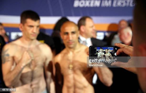 Super middleweight fighter Nikola Sjekloca of Montenegro and Arthur Abraham pose during the weigh in at Maritim pro Arte Hotel on May 2 2014 in...