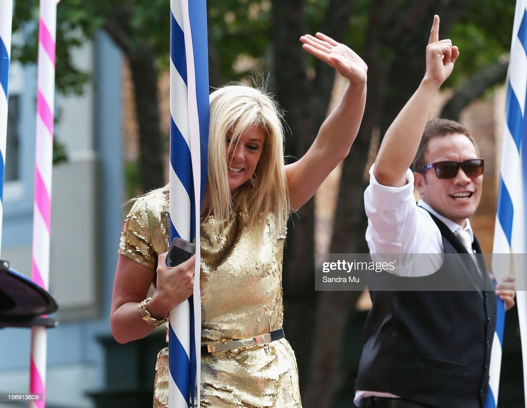 Super model and New Zealand's Got Talent judge Rachel Hunter (L) and hosts Tamati Coffey wave to the thousands of people lining the street to watch the Farmers Santa Parade on November 25, 2012 in Auckland, New Zealand. For 78 years the Farmers Santa Parade has brought joy to the children of Auckland marking the start of the Christmas season.