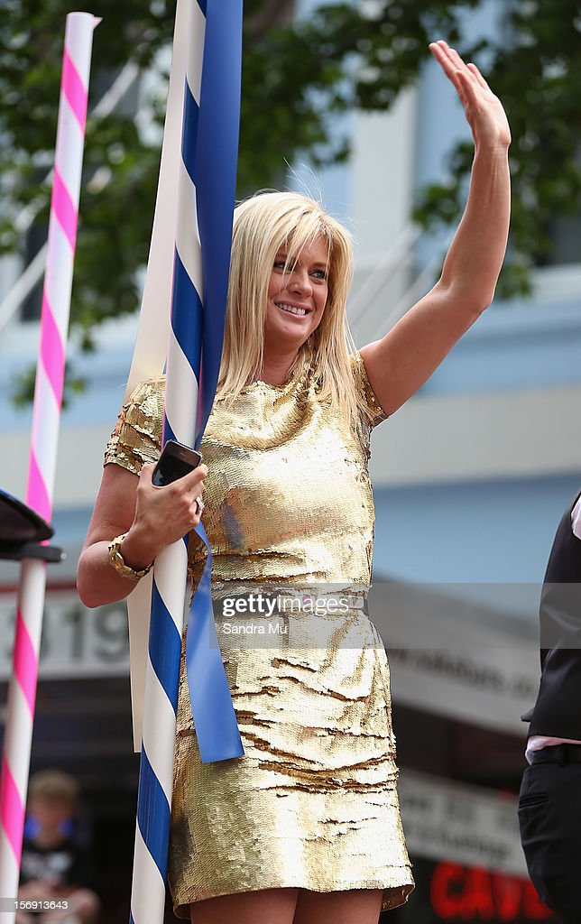 Super model and New Zealand's Got Talent judge Rachel Hunter waves to the thousands of people lining the street to watch the Farmers Santa Parade on November 25, 2012 in Auckland, New Zealand. For 78 years the Farmers Santa Parade has brought joy to the children of Auckland marking the start of the Christmas season.