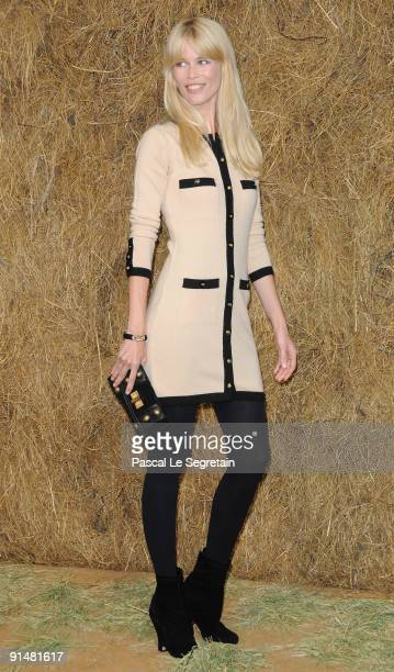 Super Model Claudia Schiffer arrives to attend the Chanel Pret a Porter show as part of the Paris Womenswear Fashion Week Spring/Summer 2010 at Grand...