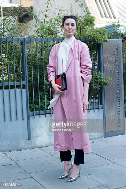 Super model Erin O'Connor wears JW Anderson coat and Dior shoes on day 2 during London Fashion Week Spring/Summer 2016/17 on September 19 2015 in...