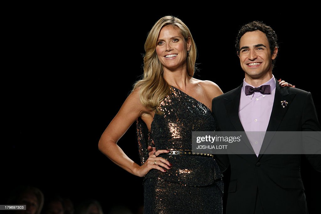 Super model Heidi Klum (L) and fashion designer Zac Posen appear on the runway at the Project Runway fashion show at the Mercedes-Benz Fashion Week Spring 2014 collections on September 6, 2013 in New York. AFP PHOTO/Joshua Lott