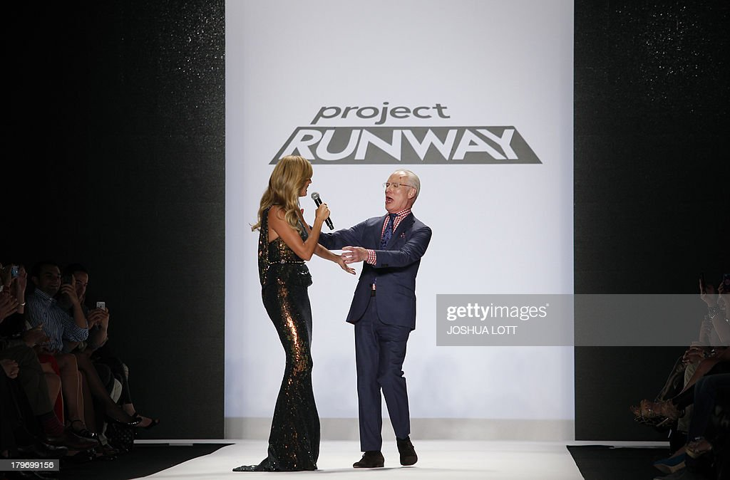 Super model Heidi Klum and Tim Gunn speak as they attend the Project Runway fashion show at the Mercedes-Benz Fashion Week Spring 2014 collections on September 6, 2013 in New York. AFP PHOTO/Joshua Lott