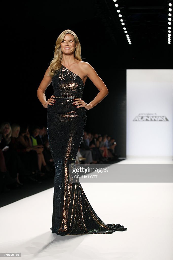 Super model Heidi Klum appears on the runway at the Project Runway fashion show at the Mercedes-Benz Fashion Week Spring 2014 collections on September 6, 2013 in New York. AFP PHOTO/Joshua Lott