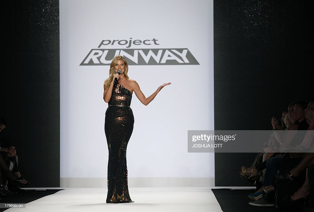 Super model Heidi Klum speaks as she appears on the runway at the Project Runway fashion show at the Mercedes-Benz Fashion Week Spring 2014 collections on September 6, 2013 in New York. AFP PHOTO/Joshua Lott