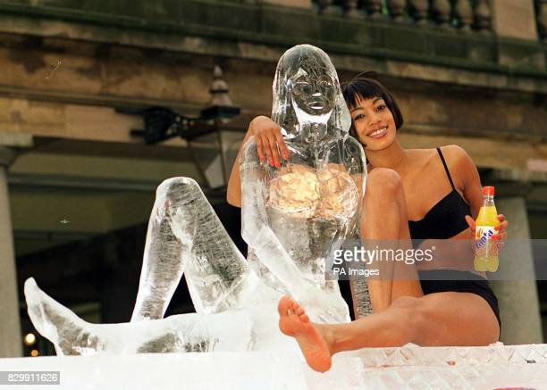 Super model Janina Davis posing in a Gucci bikini next to the lifesized ice sculpture of herself in London today for Fanta's 15 million relaunch...
