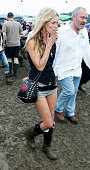 Super model Kate Moss seen at the first day of the Glastonbury Music Festival 2005 at Worthy Farm Pilton on June 24 2005 in Somerset England The...