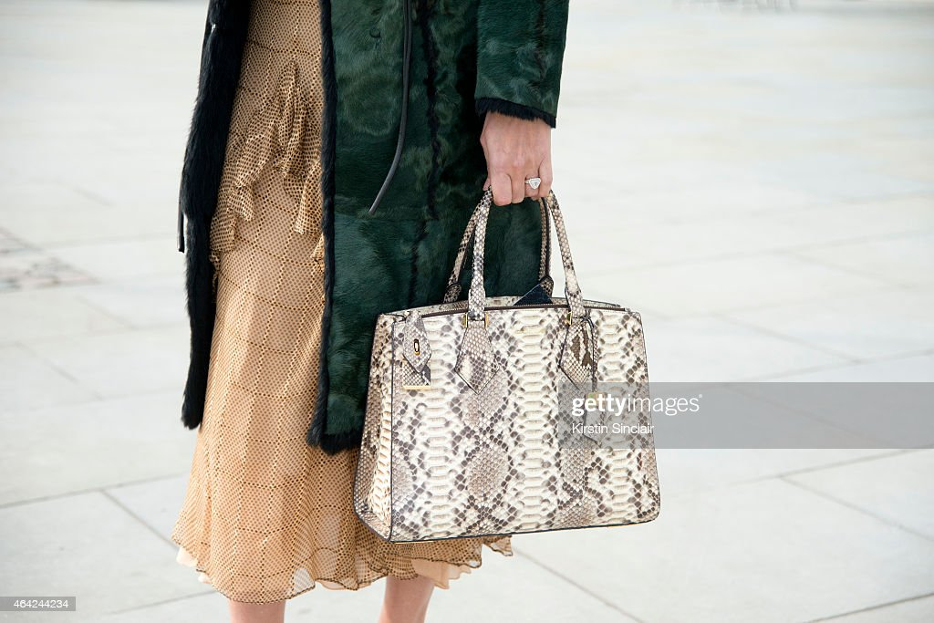 Super Model Yasmin Le Bon wears a vintage dress Gucci jacket Prada shoes Michael Kors bag and on day 3 of London Collections Women on February 22...