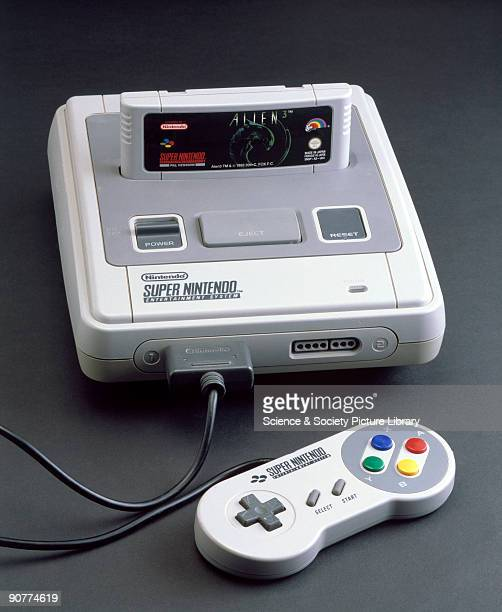 Super Nintendo Entertainment System 1992 Computer games console with 'Alien 3' game cartridge and one handheld controller made by Nintendo Japan