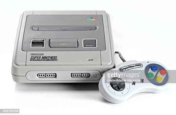 A Super Nintendo Entertainment System video game console and Competition Pro controller photographed on a white background taken on March 26 2009