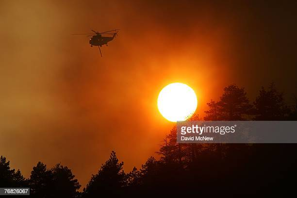 Super S61 Firefighting helicopter flown by Carson Helicopter Services flies over the Butler 2 Fire after on September 17 2007 near Fawnskin...