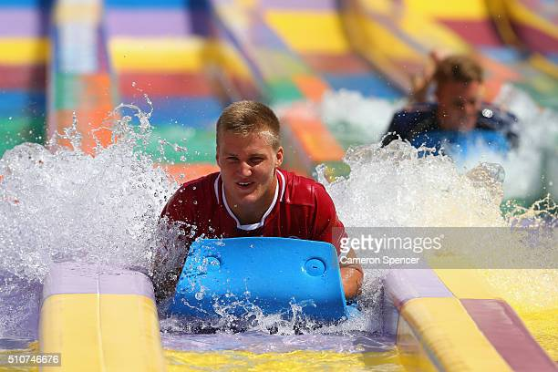 Super U20's player Fred Dorrough of the Reds rides a waterslide during the 2016 Super Rugby Australian season launch at Wet'n'Wild on February 17...