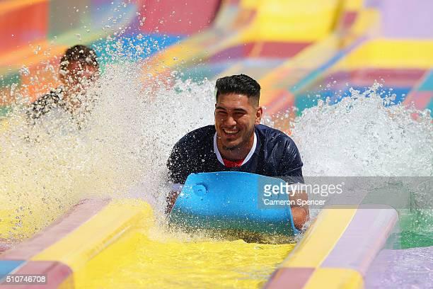 Super U20's player TangaroaAriki Hosea of the Rebels rides a waterslide during the 2016 Super Rugby Australian season launch at Wet'n'Wild on...