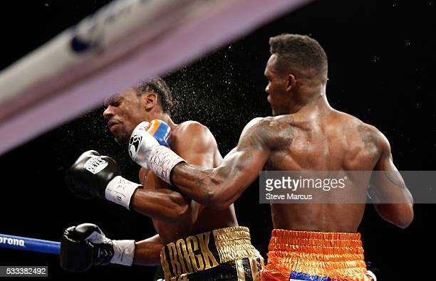 Super welterweight boxer Jermell Charlo connects with a punch that sends John Jackson to the canvas during the eighth round of their fight for a...