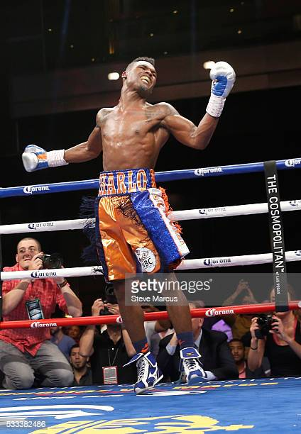 Super welterweight boxer Jermell Charlo jumps in celebration after beating John Jackson to win the vacant WBC title at The Chelsea at The...