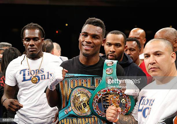 Super welterweight boxer Jermell Charlo poses with members of his camp after beating John Jackson to win the vacant WBC title at The Chelsea at The...
