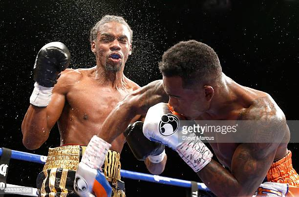 Super welterweight boxer Jermell Charlo punches John Jackson during a fight for the vacant WBC title at The Chelsea at The Cosmopolitan of Las Vegas...