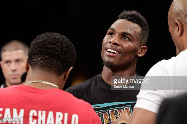 Super welterweight boxer Jermell Charlo watches a replay of his eighthround knock down of John Jackson after their title fight at The Chelsea at The...
